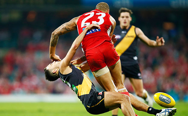 SYDNEY, AUSTRALIA - JUNE 26: Lance Franklin of the Swans knocks down Shane Edwards of the Tigers during the 2015 AFL round thirteen match between the Sydney Swans and the Richmond Tigers at the Sydney Cricket Ground, Sydney on June 26, 2015. (Photo by Matt King/AFL Media)