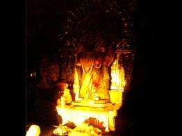 sunrays fall on the feet of the idol