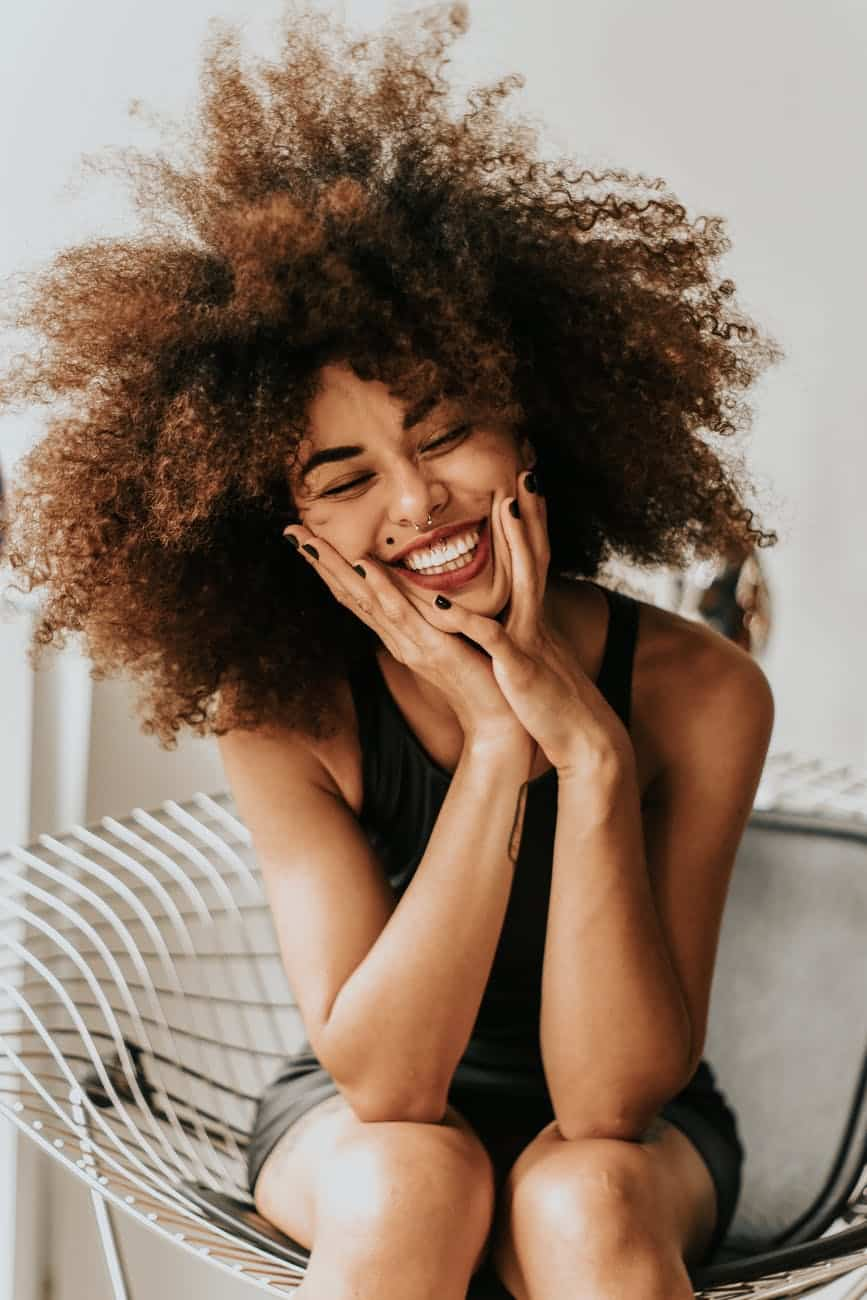 woman sitting and smiling