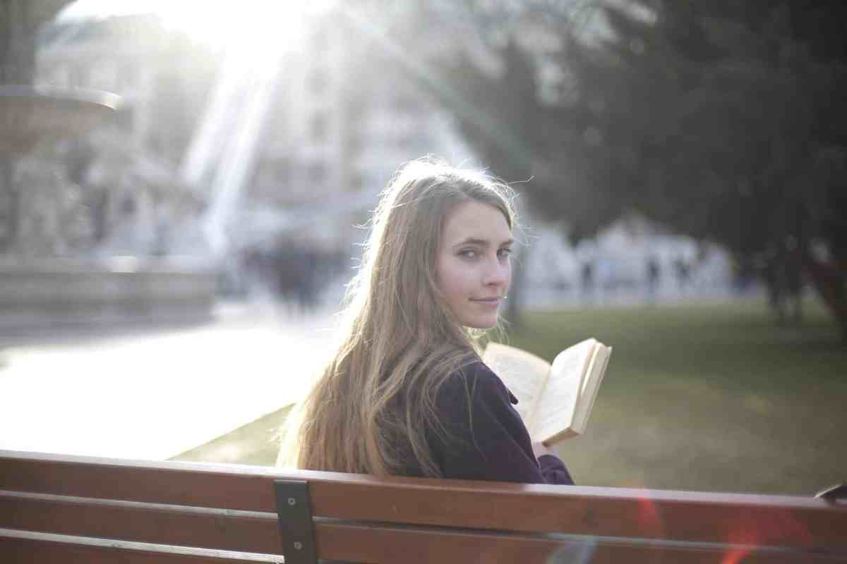 tranquil woman reading book in park