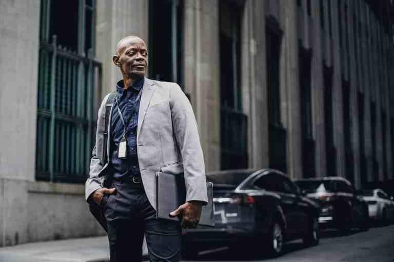 respectable black businessman standing on street