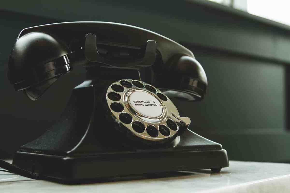 black rotary telephone on white surface Forget to Communicate