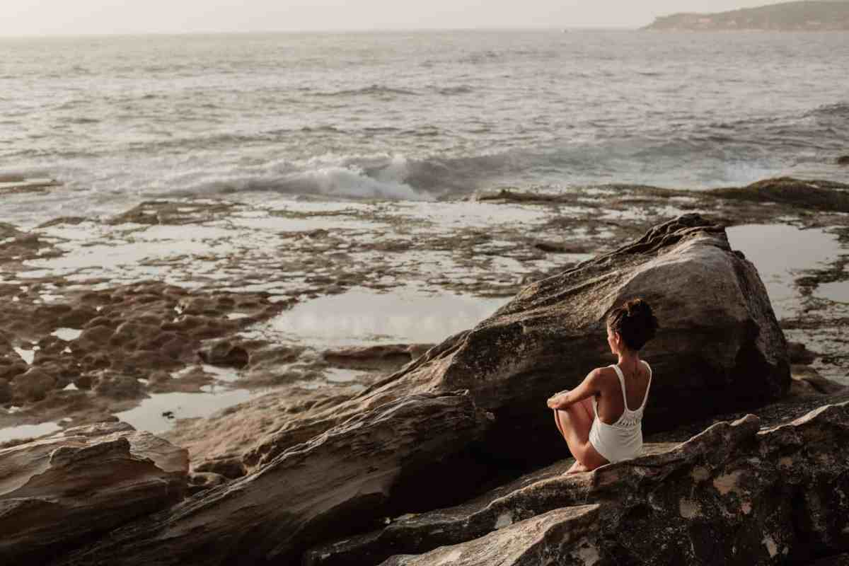 photo of woman sitting on rock - understanding how alignment works