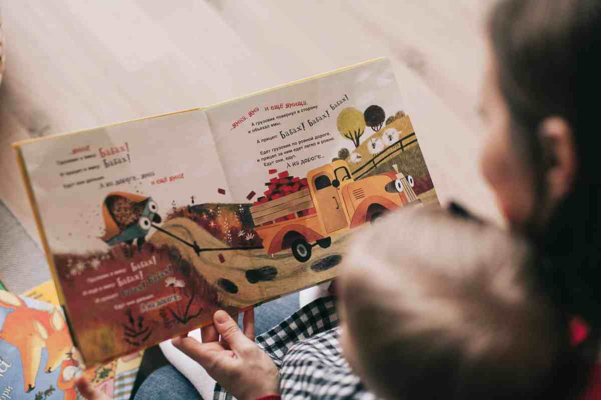 woman reading book to toddler - purpose can light you up