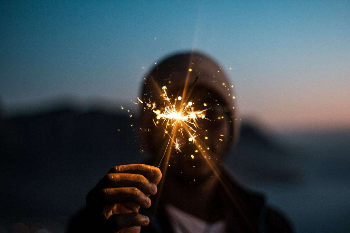 person holding fire cracker - definition of manifestation