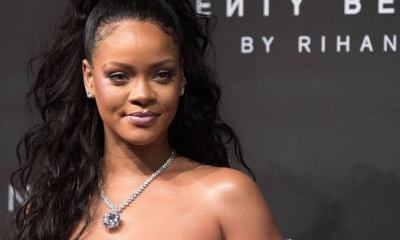 "Rihanna Helps Joe Biden Take Out The Trash In An ""End Racism"" T-shirt"