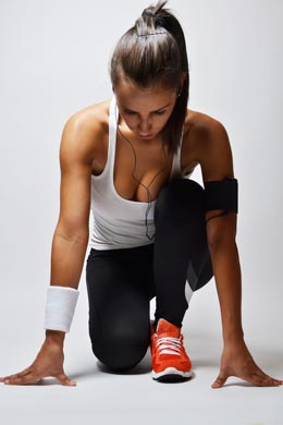 Model pretending to set up for a run