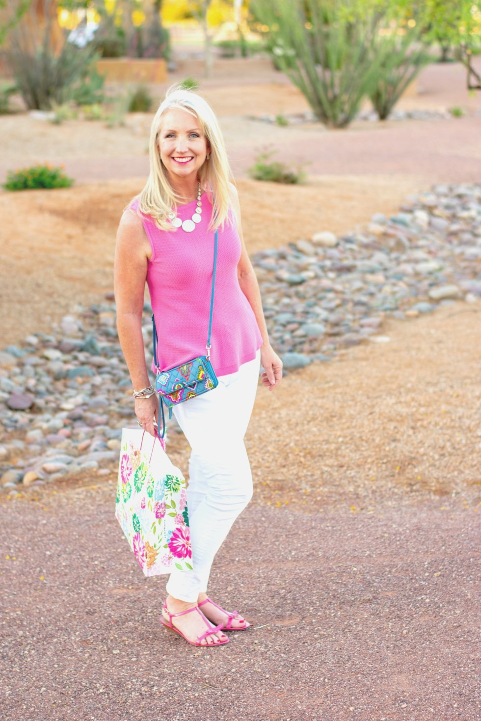 White skinny jeans with pink sleeveless sweater shell for a perfect summer style