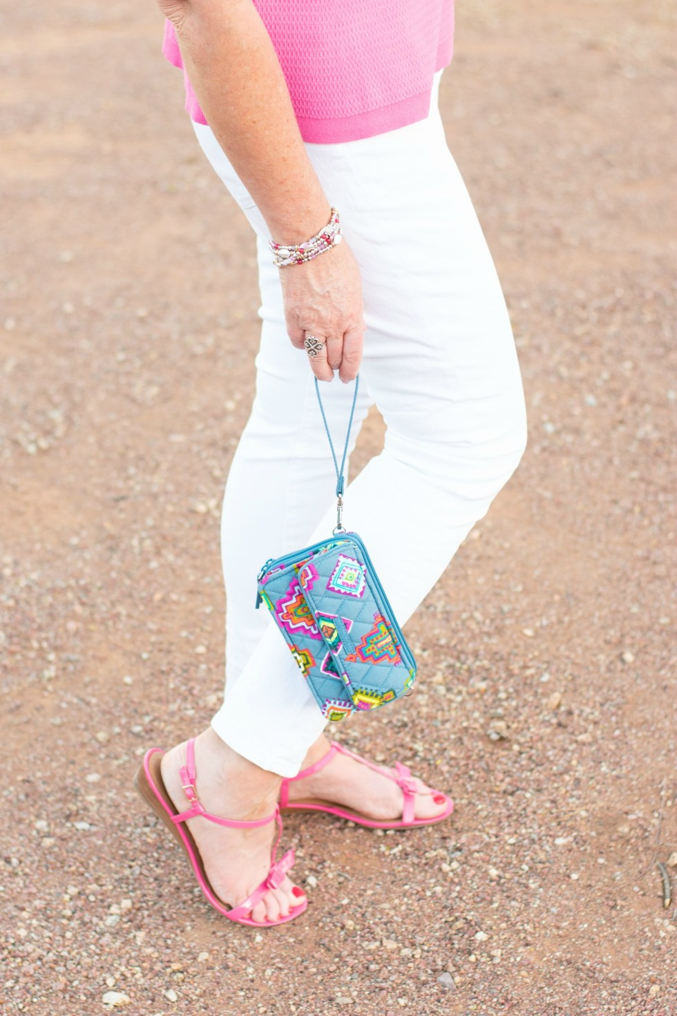 White skinny jeans with pink accents