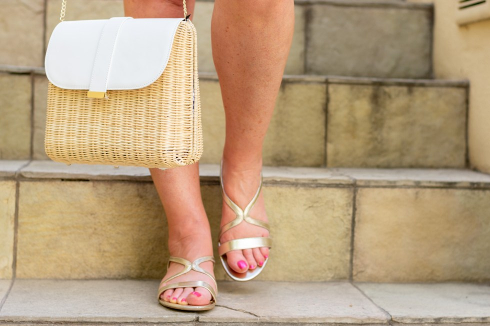 wicker and leather handbag and gold sandals
