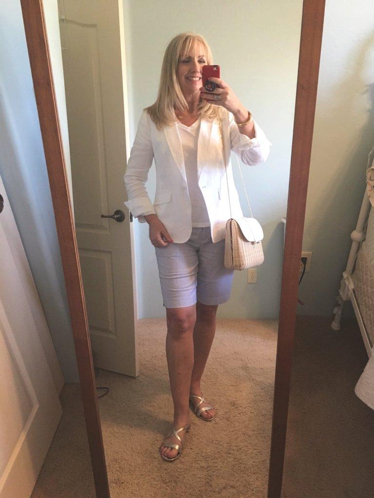 white blazer with seersucker Bermuda length shorts