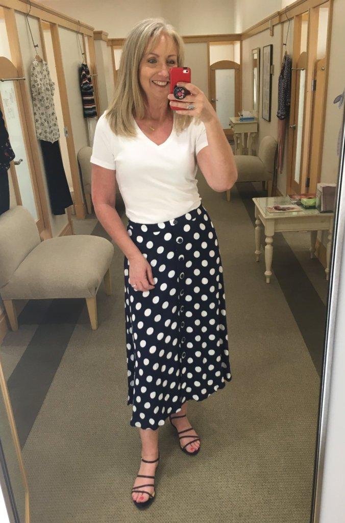 white v-neck tee with dotty midi skirt