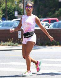 Dailymail.co.uk Christina Milian Rocks Pink Tie Dye Top. Keeping Cool: The Love Don't Cost A Thing Star Accessorized With A Black Fannypack With Compton Emblazoned On It, Pink Mirrored Wayfarer Shades And Hoop Earrings