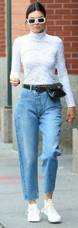 Dailymail.co.uk Cool Kid: The Model Went For A Retro Vibe Wearing Mom Jeans With A Vintage Chanel Fanny Pack And An Eckhaus Latta Rose Print Turtle Neck