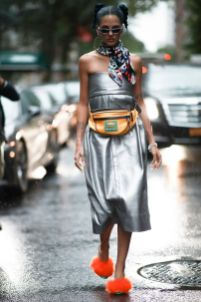 Fashionista.com On The Street At #NYFW. #streetstyle #fannypack #silverdress