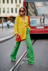 01-stockholm-spring-2019-street-style-yellow-chunky-knit-cardigan-green-wide-leg-trousers-red-bag-sunglasses