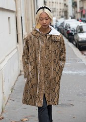PARIS, FRANCE - OCTOBER 1 : Fashion blogger Vanessa Hongof The Haute Pursuit wears a Valentino coat, Frame denim jeans, Paula Mendoza earrings and Altuzarra headband day 6 of Paris Womens Fashion Week Spring/Summer 2018, on October 1, 2017 in London, England. (Photo by Kirstin Sinclair/Getty Images)