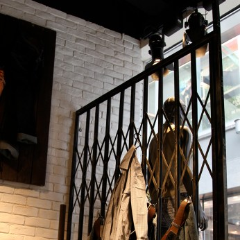 custom made sliding gate black raw steel for display fixture VMD | British Fashion Denim Retail Brand – Lee Cooper in China :: fixture and furniture for flagship store