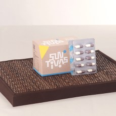 photography of biomelain pills and large box blue range individual packing capsule on rattan platform | Health Care Consumer Goods Distributor – AML Food :: retail imaging