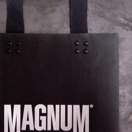 medium size paper black shopping bag, retailing packaging | Magnum Essential Equipment :: branding identity design