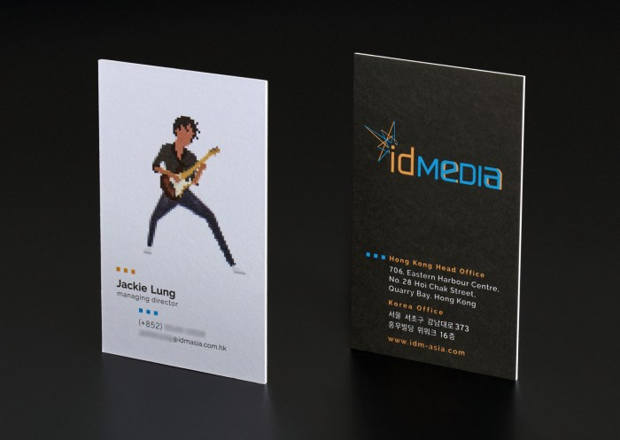 A leading Asian Digital Marketing Agency Brand based in Hong Kong and office in South Korea :: Identity Revamp and New Business Card Design :: business card, name card, dynamic branding, personalisation pixelated figures of every individuals, black table top, anglar view, 1 executive, JL guitarist in action, front and back standing