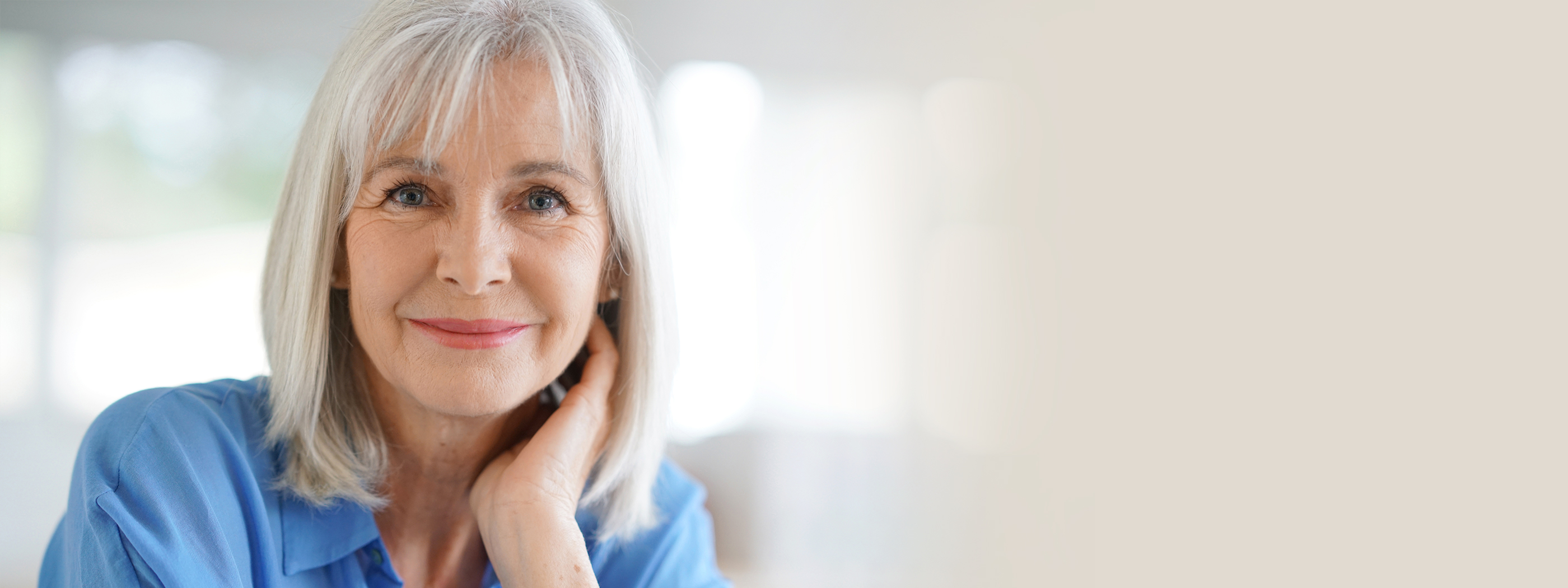 Attractive older woman with white hair smiling