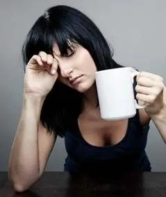 tired woman with coffee