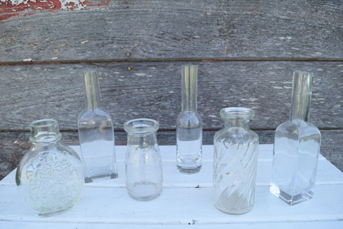 Assorted vintage glass bottles