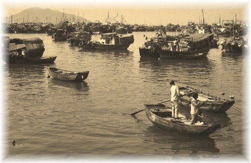 Cheung Chow Harbour, at least three generations seemed to live on each boat and... half the fleet was out fishing at any given time!