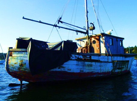 Down at the bow. a sad end for a once-beautiful fishboat.