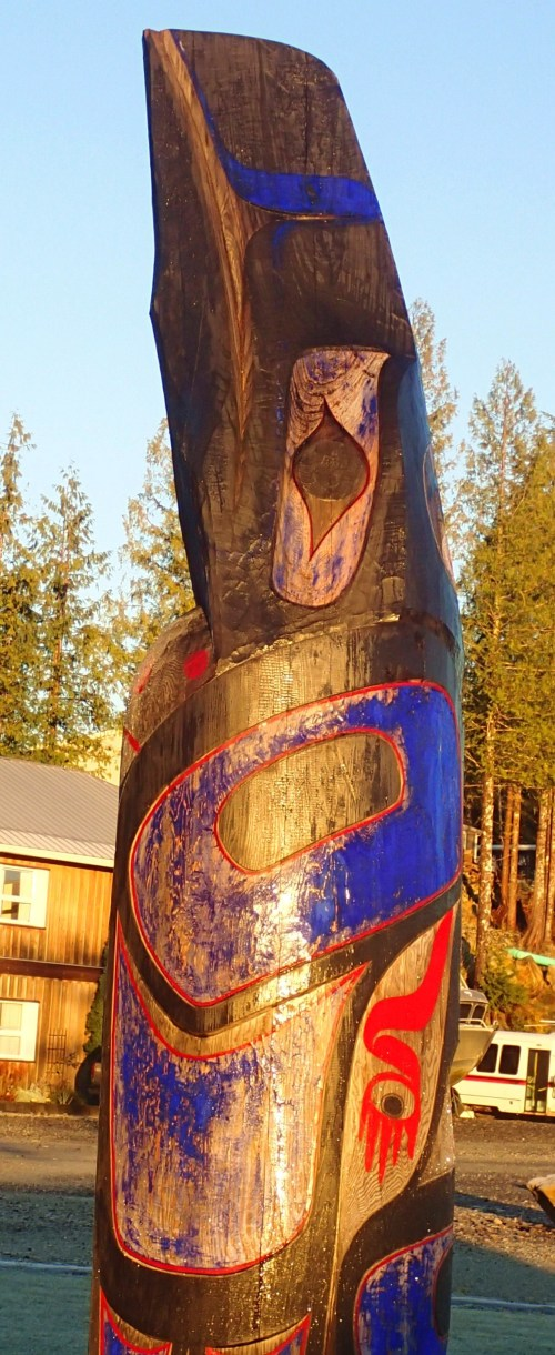 Heiltsuk Dawn. Wet with melted frost this totem pole commands the Shearwater foreshore
