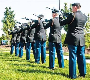 www.riley.army.mil A seven-man firing party conducts a rifle volley during a ceremony