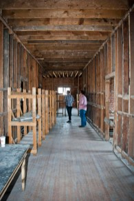This hallway separates the future kitchen from the dining area. Chris Shanks and Brandon Wright show off the area.
