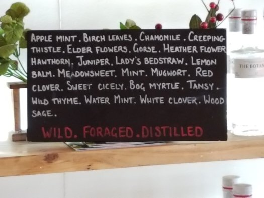 List of the botanicals that go into The Botanist gin in the gift shop at the Bruichladdich distillery on the Scottish island of Islay