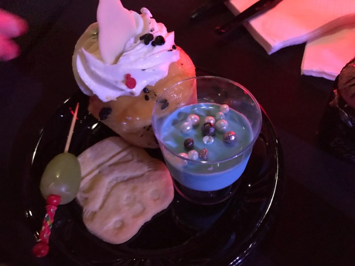 """Blue milk panna cotta, stormtrooper shortbread cookie, """"lightsaber"""" with grapes, and a BB-8 lemon cupcake"""