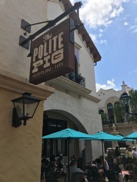 Sign for the Polite Pig and and some of the outdoor seating