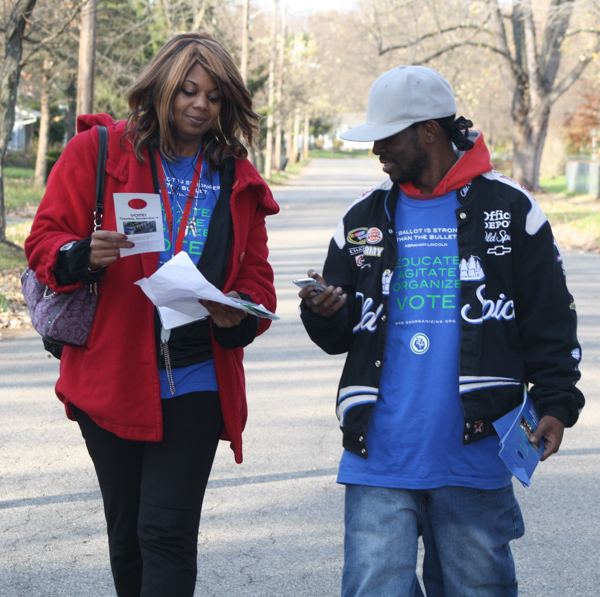 two African American citizens work to register voters in Ohio