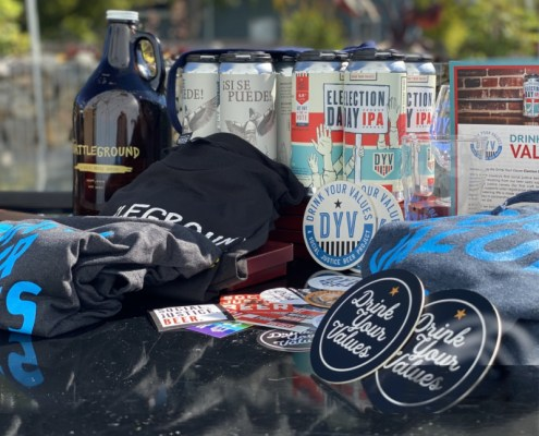 membership swag assortment shows dyv shirt, stickers, craft beer, and more