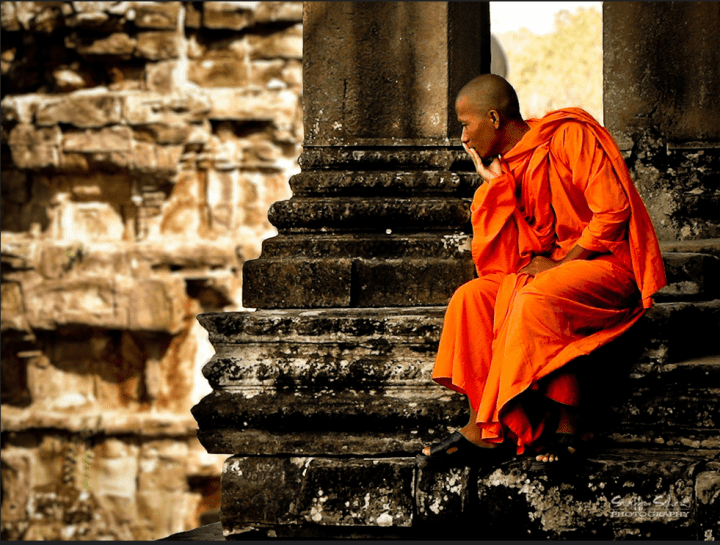 Monk Sitting in Angkor Wat