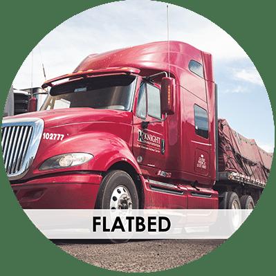 Knight Transportation flatbed truck on gravel road