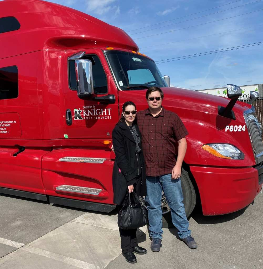 Two experienced truck drivers in front of a knight transportation truck