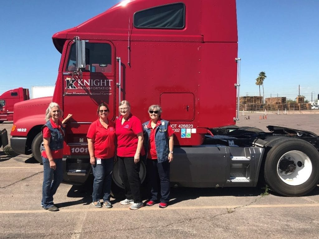BLue star moms standing in front of a Knight Transportation truck