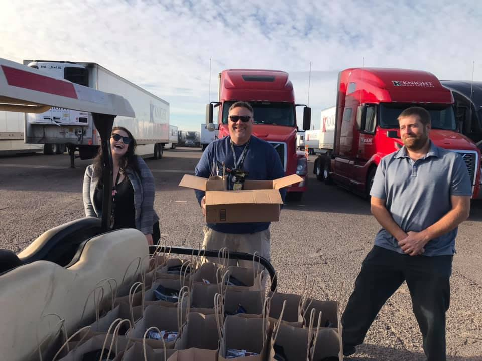 Volunteers at Buckeye, AZ terminal unloading boxes of food for drivers