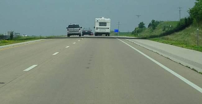 Blue road sign on US Highway - Credit: Corey Coyle