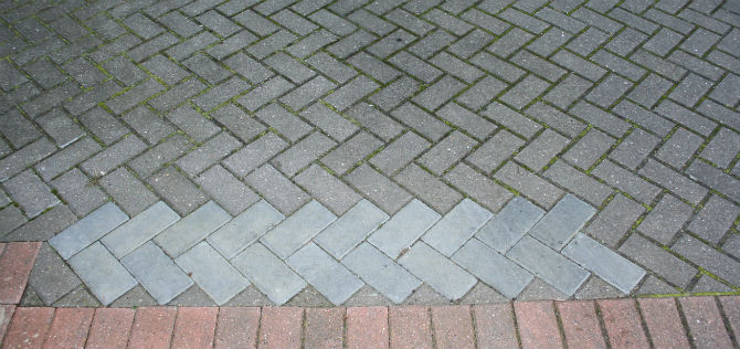 Block paving repairs Herringbone block paved driveway repair close up