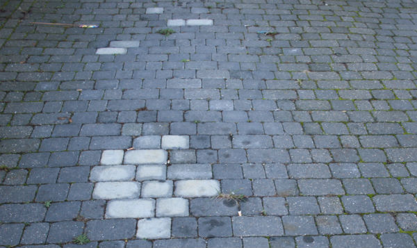 Block paving repair after oil spill on driveway