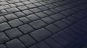 Charcoal colour pattern imprinted concrete driveway