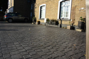 period house with imprinted concrete driveway