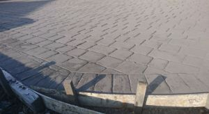 pattern imprinted concrete installation wash off of Imprinted concrete release powder