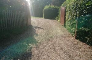 sweeping gravel driveway